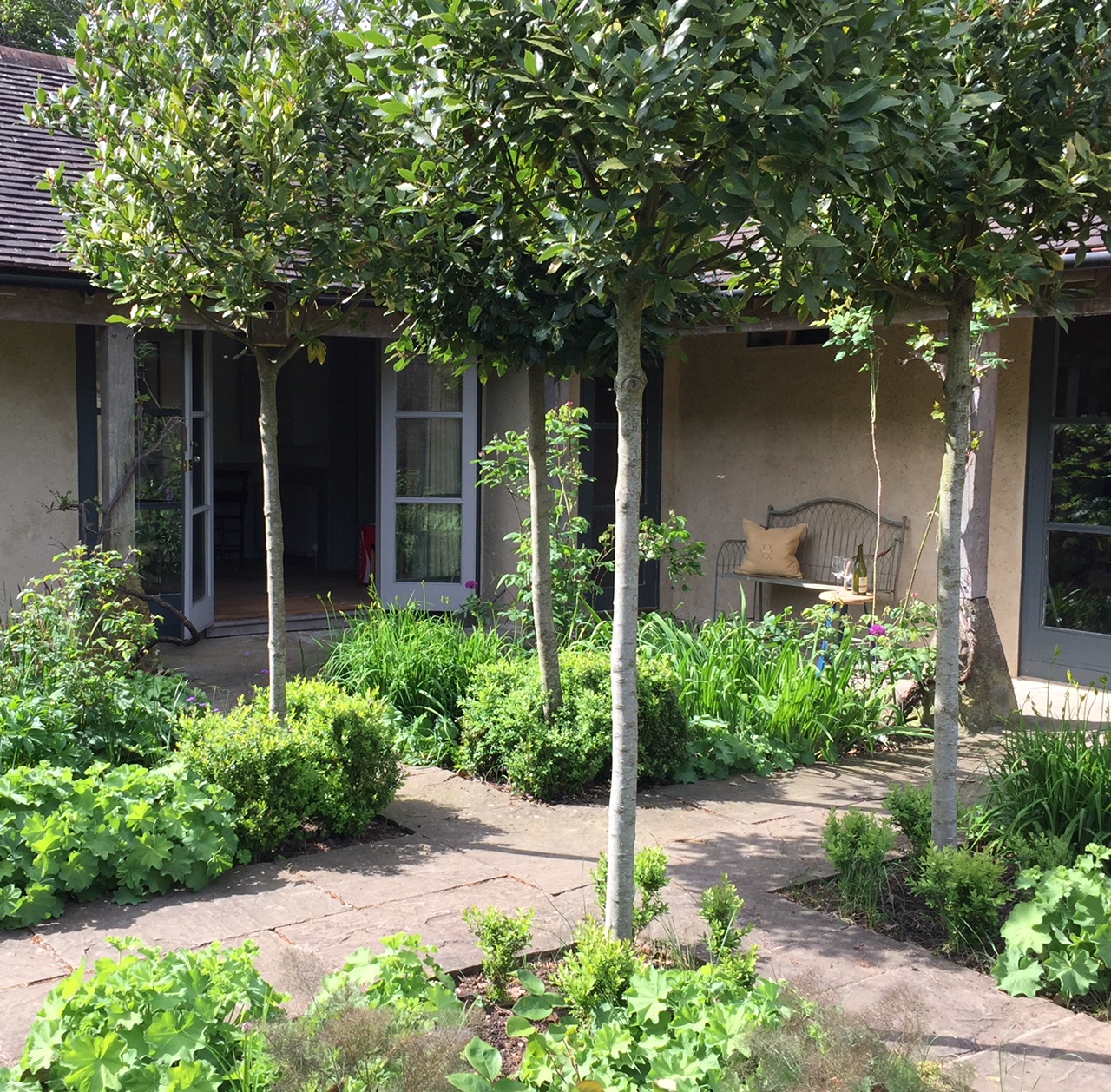 - French doors open onto courtyard garden