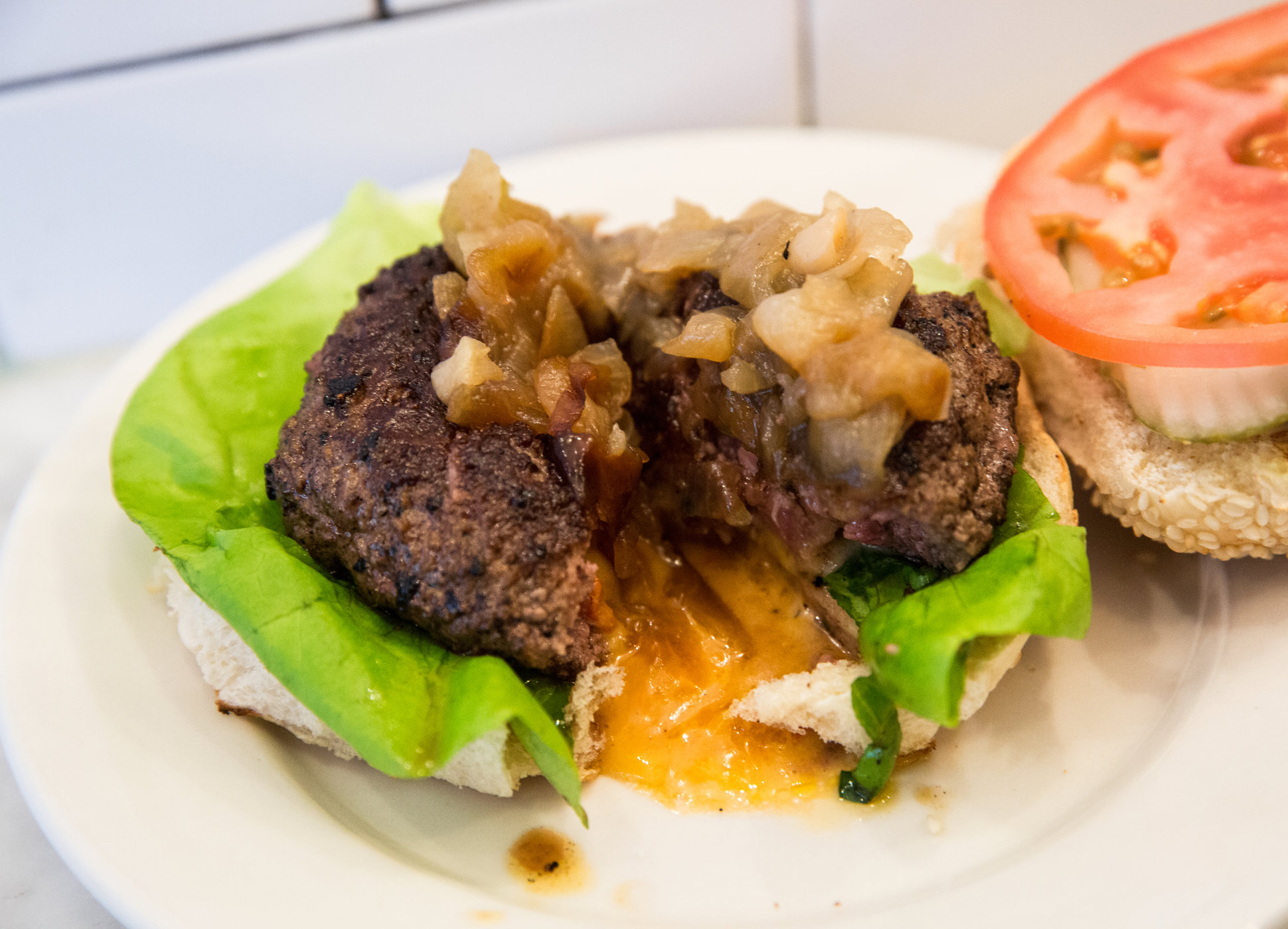New York City's Best Burgers: The Definitive Guide - By LUCY MEILUS Updated On 03/26/2018 at 05:45PM EST@lucymeilusMinnesota's state cheeseburger has a loving home in the East Village. The beef/short rib blend featured in the Juicy Lucy at Whitmans comes stuffed with an almost overwhelming amount of pimento cheese (cut it open if you're looking for the safest, least shirt-damaging route in) plus caramelized onions and special sauce on a sesame bun. While we may not be very thankful for hockey, we should all be indebted to Minnesota for a burger that oozes this much cheese.Read on Thrillist