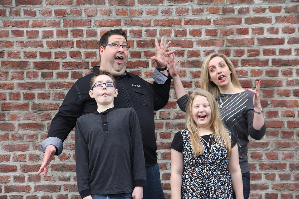 Joel and his (lovely) wife and kids, enjoying the process a little too much.