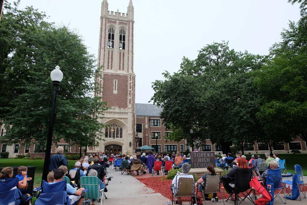 Concert-goers enjoy a summer evening filled with patriotic tunes played on the Topeka High chimes.