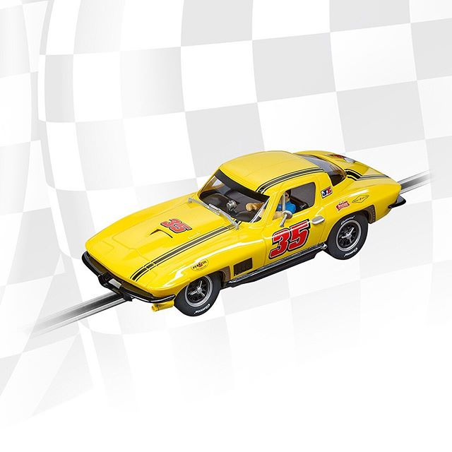 WOW! The bright yellow Chevrolet Corvette Sting Ray attracts everyone's attention. 🤩  #carreramoments #carreratoys #slotracing #cars #slotcar #racing #fastcar #whatacar #corvette #chevrolet #carreracars