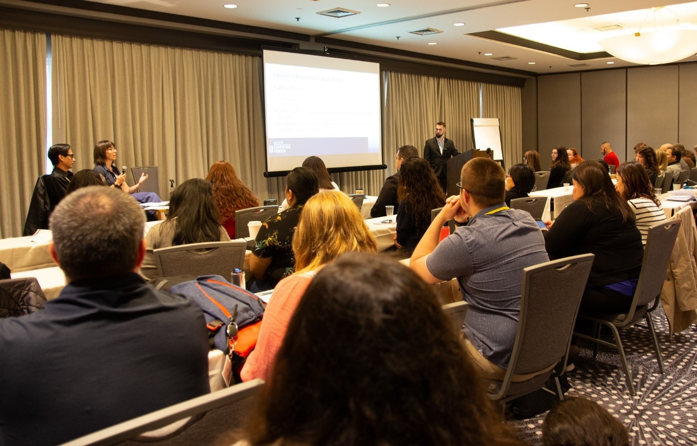 """Bronwyn Richardson, Business Intelligence Analyst, and Gerry Melgar present the session """"Reporting Workbench: How to Leverage Within Your Service Area."""""""