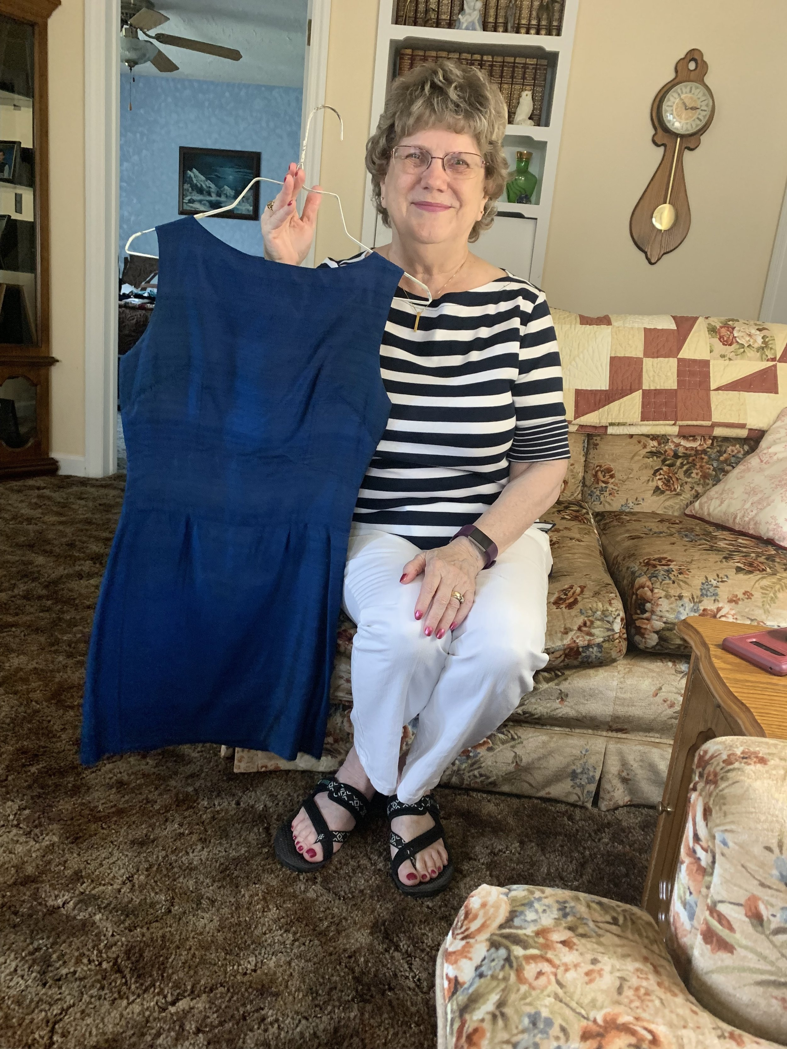 Mary shows the dress her husband handmade for her while in Thailand. The outfit dates back to 1967: the year Mary waited for her newly betrothed to return from the Vietnam War.  Photo submitted by Allie Jennerjahn