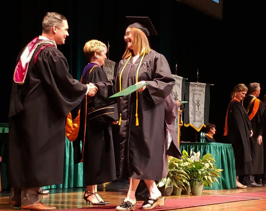 High school graduate Breanne Morgan walks across the Ivy Tech graduation stage on May 17 to receive her associate's degree. Morgan will be attending Indiana Wesleyan University in the fall.  Photo submitted by Josselyn Schick