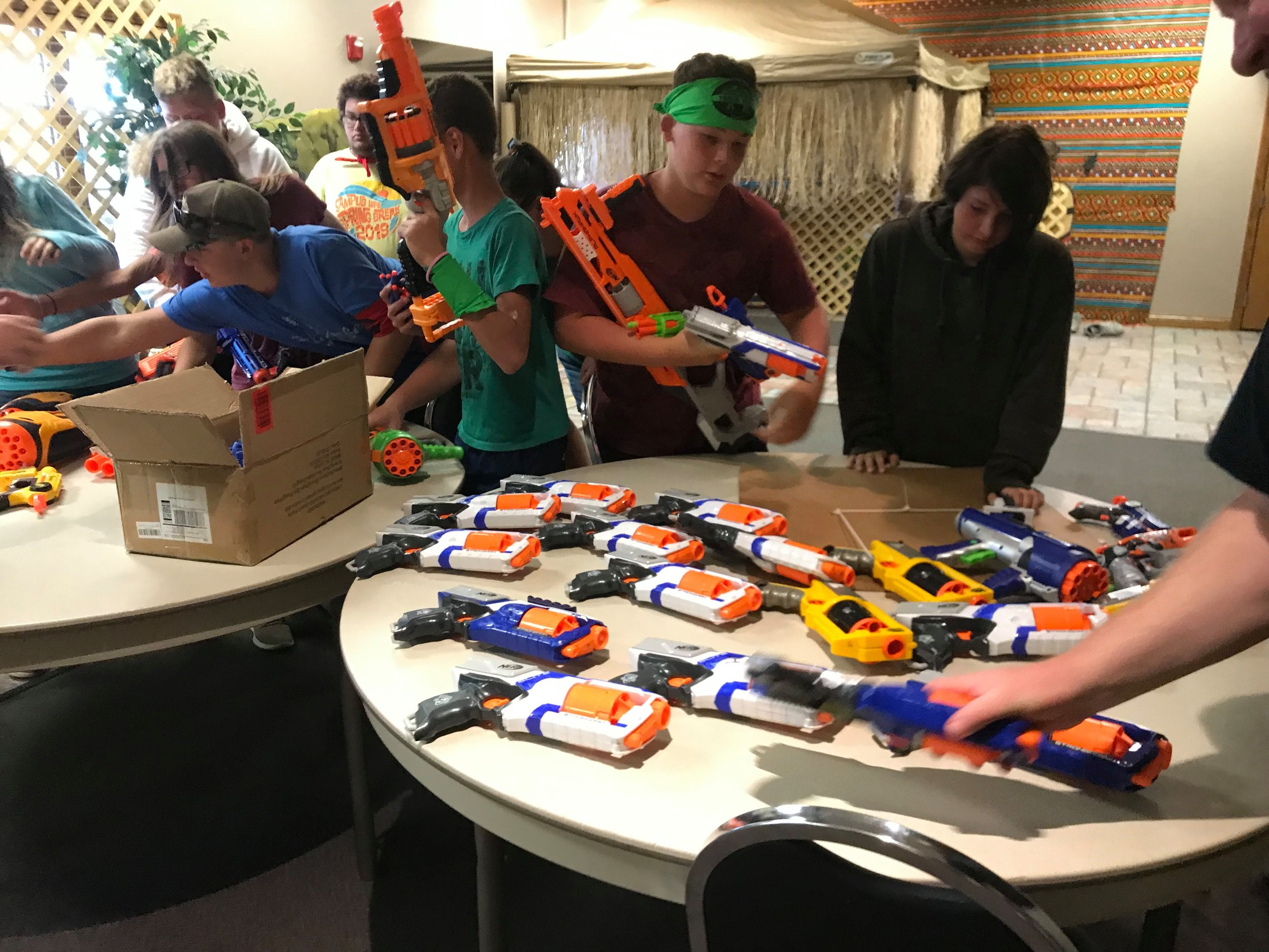 Teens gather guns and darts for a Nerf War at the Lighthouse Church on July 1.  Photo submitted by Jordan Walda