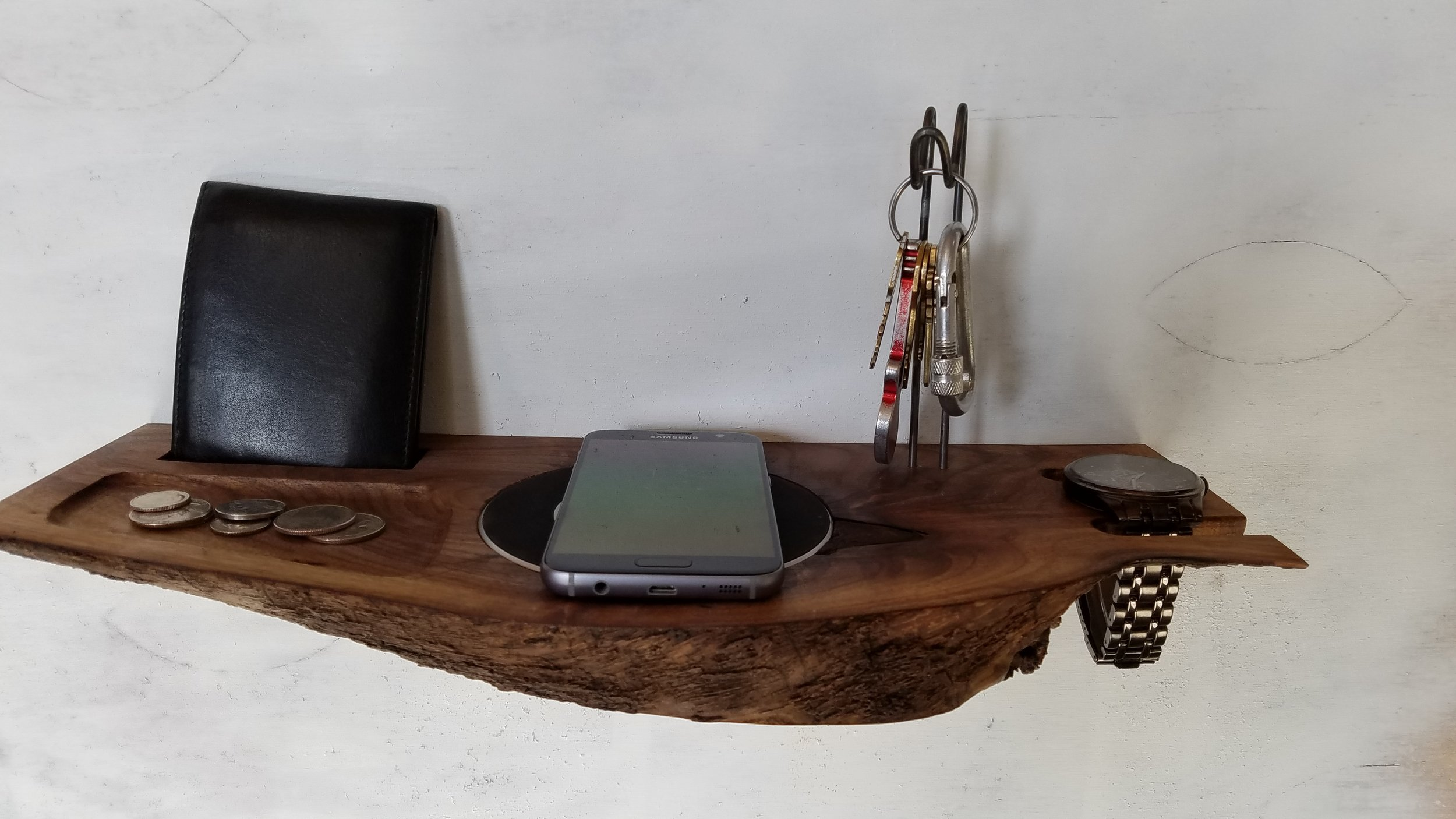 Wall Valet - This wall mounted valet is made with live edged Black Walnut which was harvested using urban forestry techniques. It contains a built-in wireless phone charger.