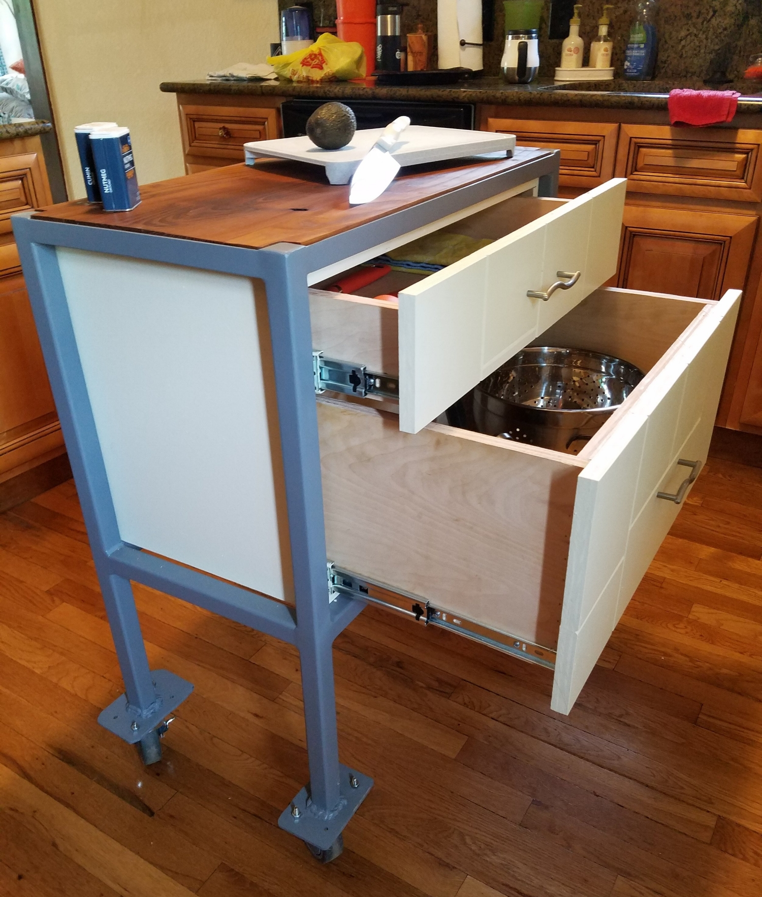 Kitchen Island Cart - Ideal for the small kitchen that needs flexible working and storage space, this sturdy steel frame used to be a utility cart in a mechanic shop for commercial trucks. The painted cabinet has two soft close drawers, and the Russian Olive wood top is finished with food-safe bee's wax and mineral oil.