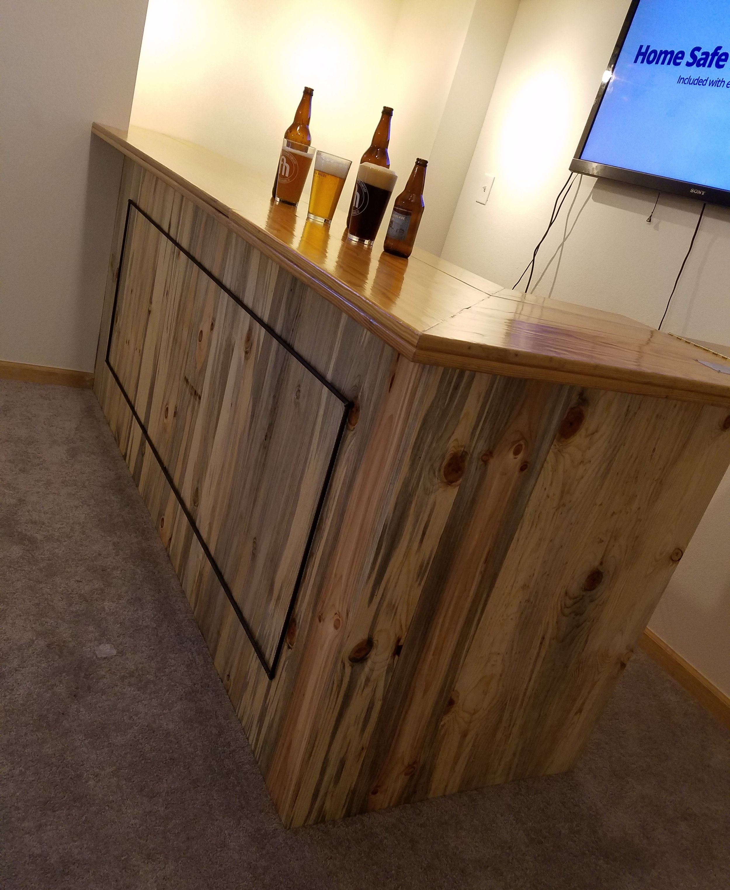 "The ""Hebart"" Built-in Bar - Pronounced ""Eh-Bar"", this little gem was custom built for a couple of clients that are sports FANATICS, so what better material for a bar top that reclaimed bleachers from Denver Public Schools! The frame is made of reclaimed 2x4's glazed black, the bottom is clad in Beetle Kill Pine from forest mitigation projects, and the accent on the front is recycled rebar."