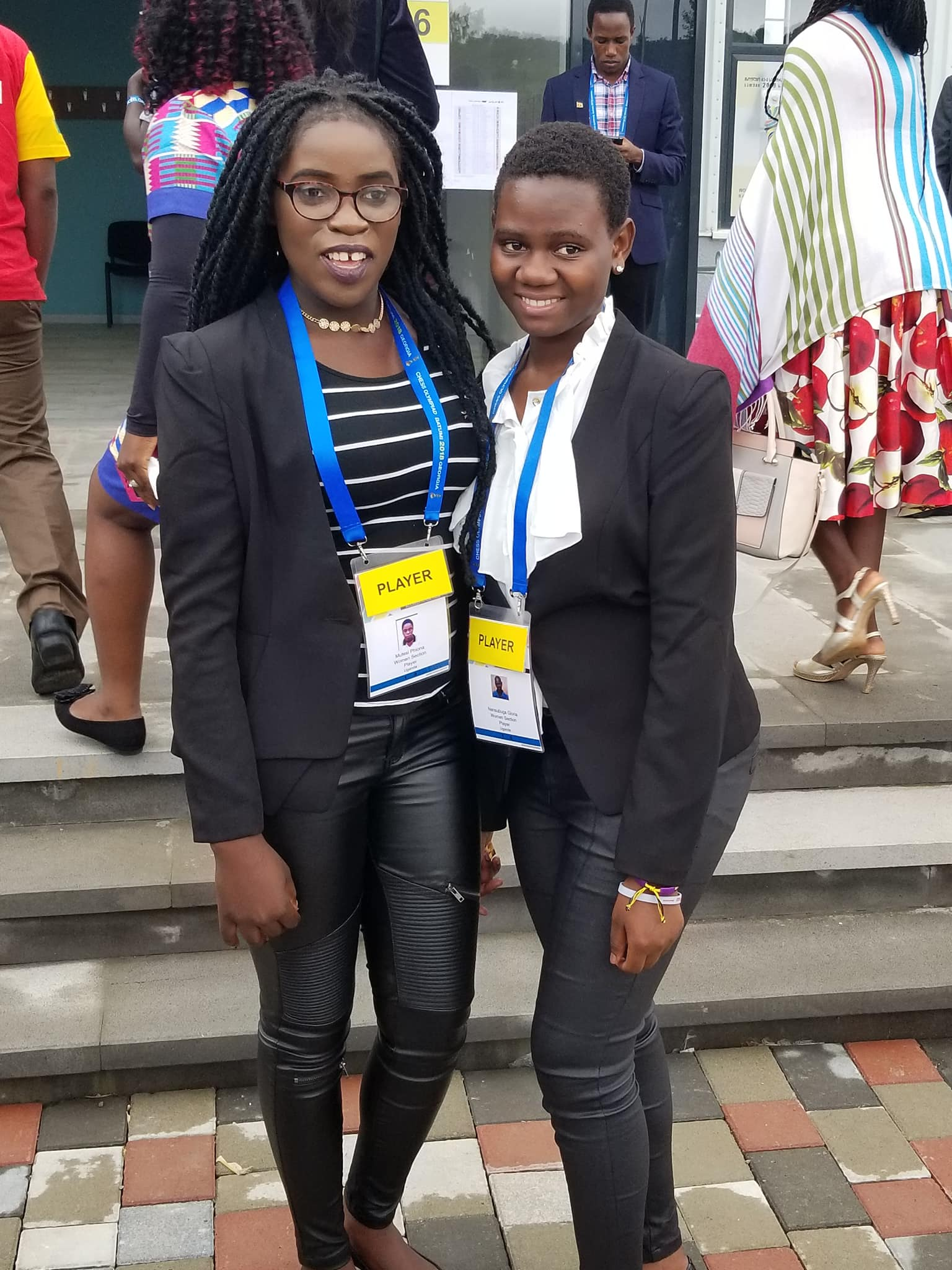 At five years old, Gloria Nansubuga (pictured right) taught Phiona Mutesi (pictured left) how to play chess. Now they are teammates in the World Chess Olympiad.