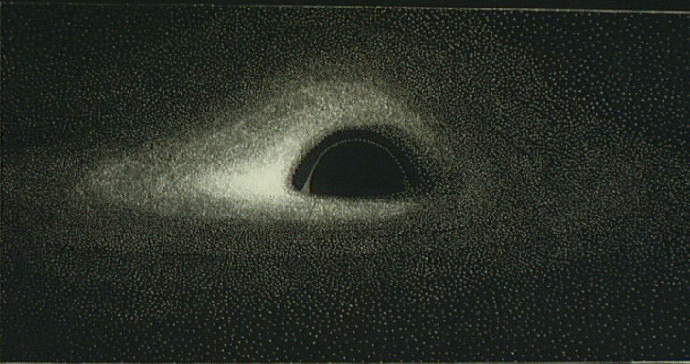 Computer-generated image of a distant black hole, from http://luth2.obspm.fr/~luminet/chap10.html .