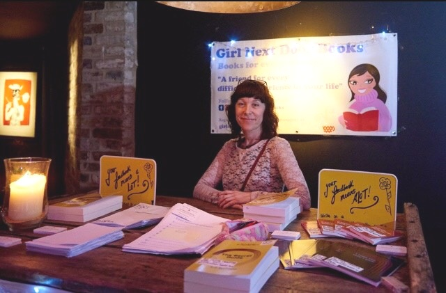 Olivia at her Girl Next Door Books stand at Morning Gloryville
