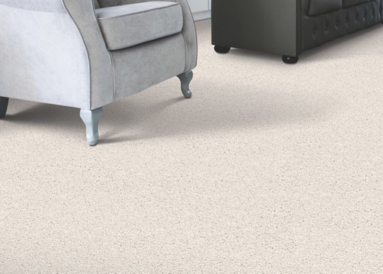 Textured: An American Favorite - This is a very popular cut pile carpet that has alternating twists of yarn creating a two-tone appearance.The pile yarns have more twist so that the yarn ends are visible and create a more casual look. This construction minimizes foot prints and vacuum marks and can be great for high traffic areas. The more times the carpet is twisted the longer the carpet will wear and the less it will crush.