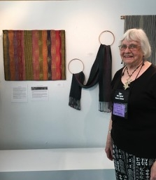 Norma Smayda with her work at the NEWS Special Exhibit: Passion for Weaving Three Master Weavers of Rhode Island