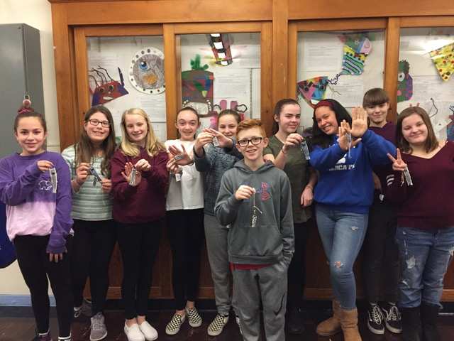 Happy weavers from the Wickford Middle School. These talented young students are showing the inkle bands they wove during our two sessions. Their individual bands were made into keychains as a memento of our time together.