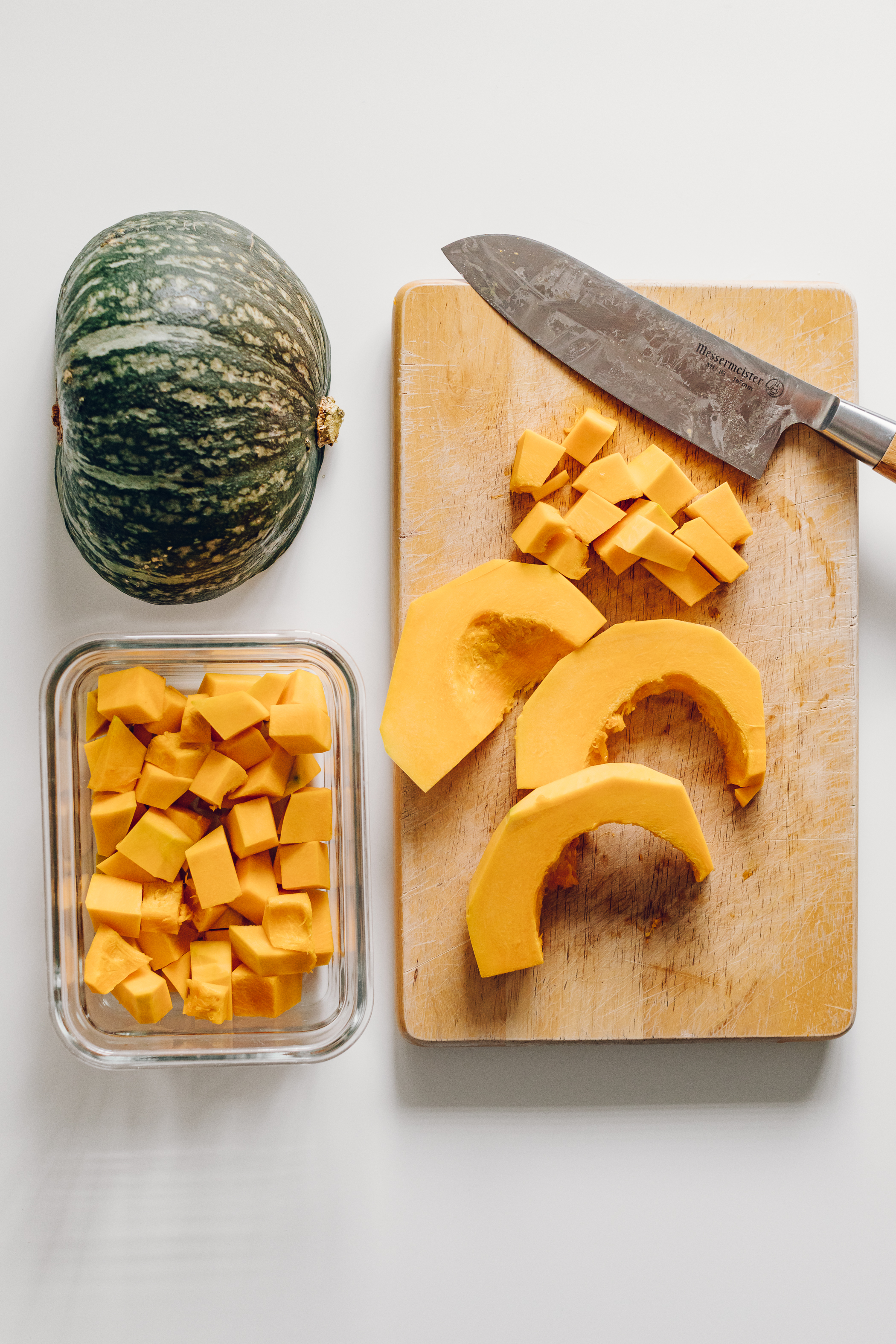 Kabocha Squash (Pumpkin) - The kabocha squash is the variety of pumpkin we eat the most of in the fall season. This method works well for butternut squashes (and I'm sure others) too, and keeps fresh for one week.Step 1: Wash any dirt off of the pumpkin and dry.Step 2: With a sharp knife, carefully slice the pumpkin in half and scoop out the seeds.Step 3: Slice the skin off of each half (again, carefully).Step 4: Dice into small cubes, and place in glass containers.Step 5: Store in the fridge and use throughout the week.Tip: You can slice and roast this pumpkin with the skin on if you prefer, I just enjoy my pumpkin this way.Use: I love throwing a few handfuls into my steamer basket meals in the evening to then enjoy with hummus or a drizzle of tahini and lemon juice. Also for simmering in lentil soups!