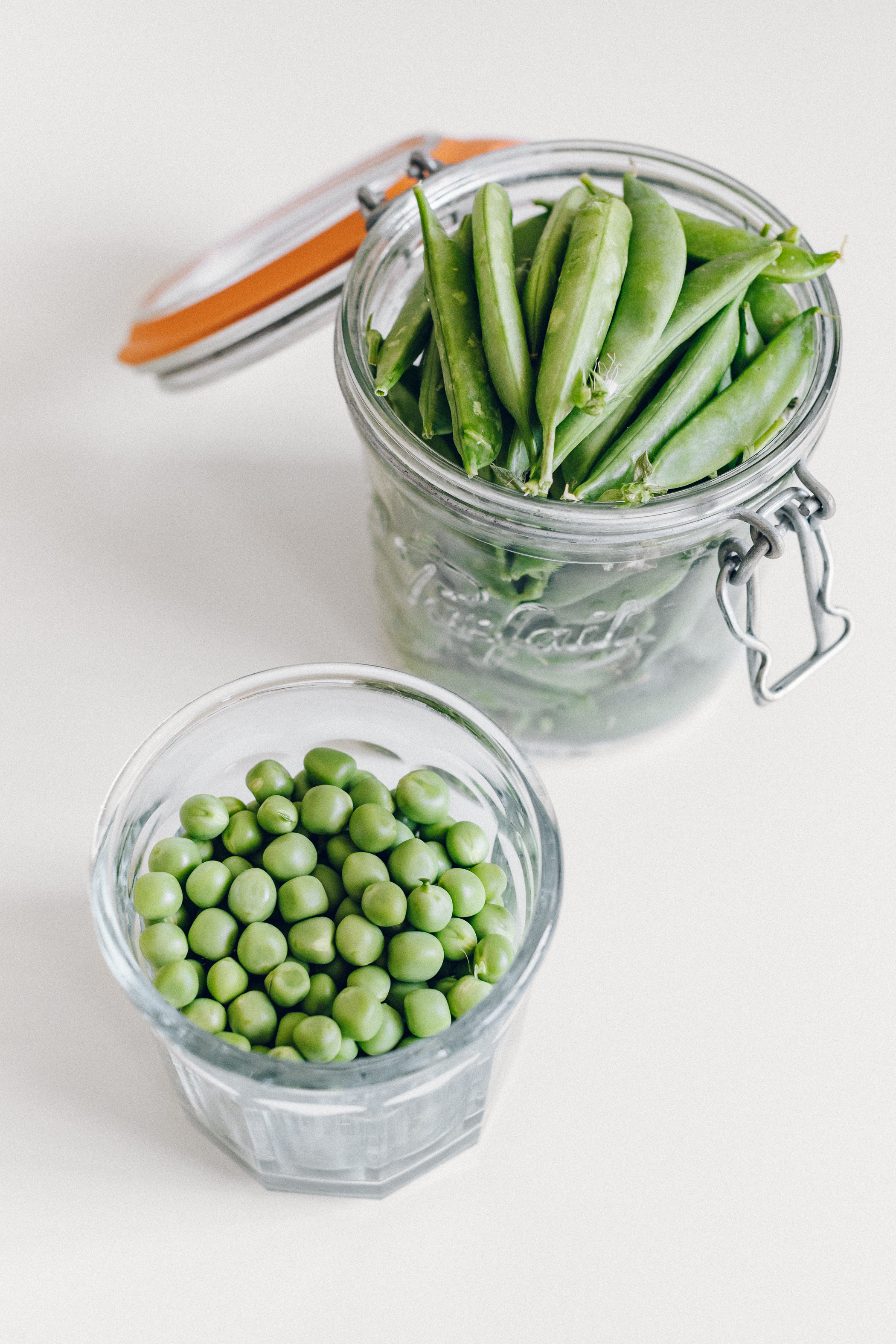 Sugar Snap Peas - These (and snow peas) come in as a close second as my favorite spring veggie. And can be stored the same way, too.To capture and hold onto the water that keeps peas so fresh and crisp, simply place in an airtight jar or container.Remove, rinse, and prepare as you please! I love using these raw in salads for a sweet crunch, or giving them a quick steam to go along with other beans, grains, veggies, and a sauce for dinner.These are important to only buy in season for the crispest, sweetest taste. Look for snap peas that are bright green and preferably a little bulging from their peas inside, meaning the farmer let them grow to maturity and didn't pick them too soon!I recommend enjoying these within a week.