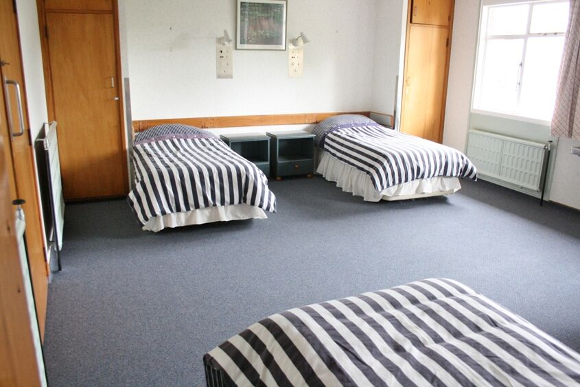 4 Single beds in Quad Room