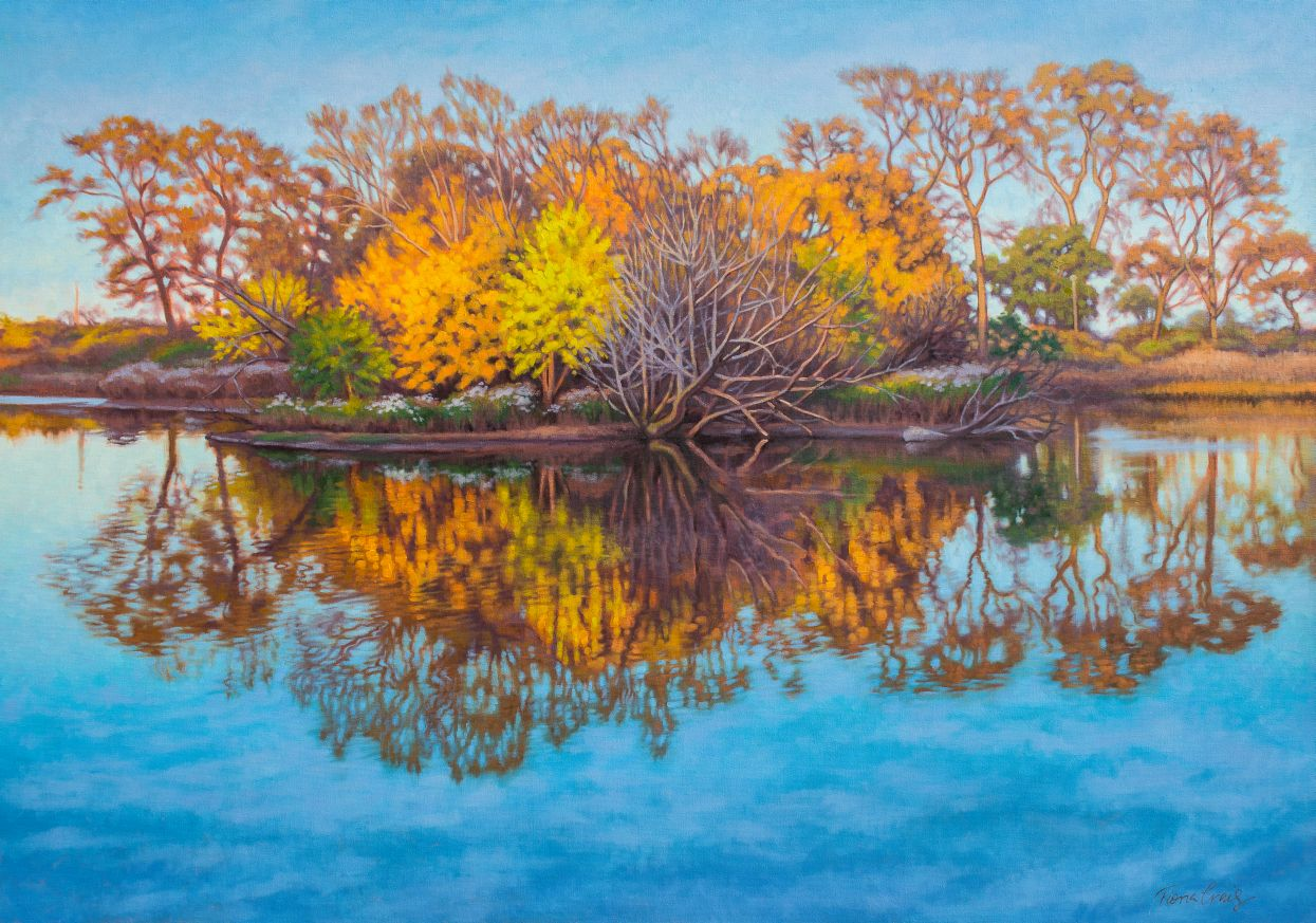 "Autumn on South Pond - Oil on gallery-wrap canvas, 38"" x 54"" x 1.5"", ready to hang. A frame can be added. Sunlit autumn trees are reflected in a pond in a nature preserve. The late afternoon light casts a golden glow over brilliant foliage, creating a vibrant contrast to blue sky. The mirrored trees form a beautiful pattern in softly rippling water. Although colors are brilliant, the whole presents a tranquil scene."