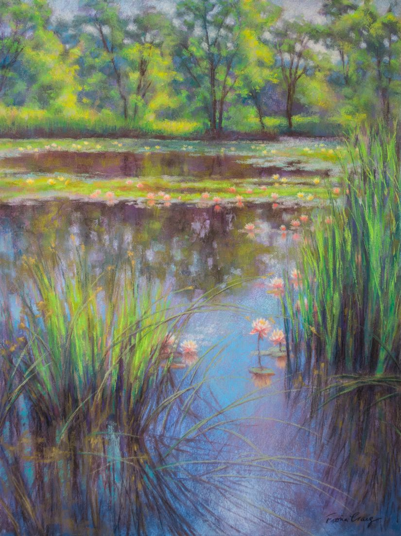 "Water Lily Pond, 1 - Soft pastel on wood panel, 18"" x 24"" x 1/8"". Requires framing under glass. This tranquil, summer scene was inspired by a wetalands nature preserve. Water lilies blossom across a pond surrounded by reeds and lush, green forest trees."