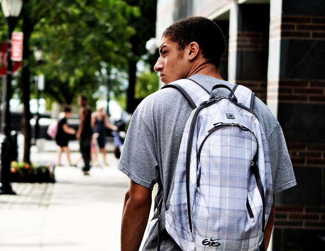 Adolescent w backpack Grit.jpg