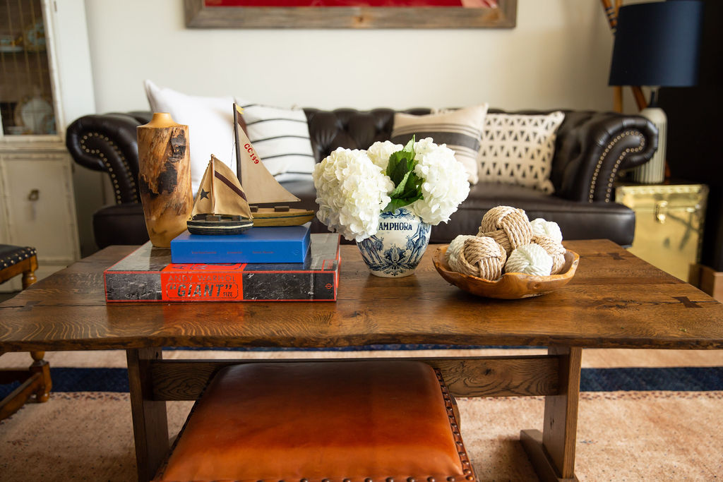 Here I combined vintage sailboats and vases with more contemporary items, like oversized fashion books and round rope balls, to create a styled coffee table vignette. The coffee table is handmade by Shepherd Design Co., a Milwaukee-based custom woodworker and furniture builder.