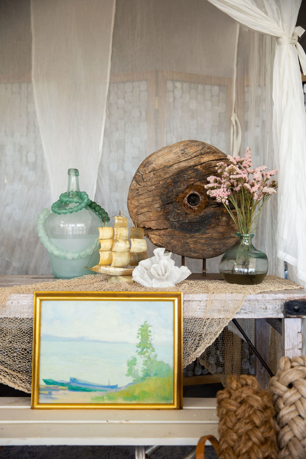 This may be favorite vignette of the bunch. There are two standout items here: an antique wood cart wheel sculpture, and landscape painting by Frederick Frary Fursman dating back to the early 20th century.