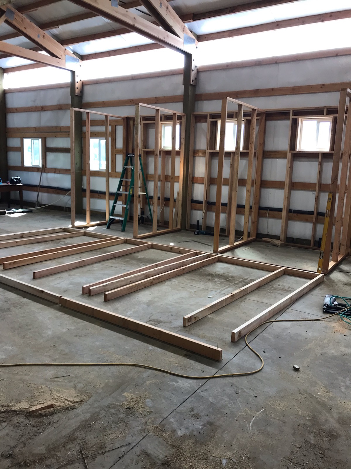 The basic framing going up for three bathrooms.