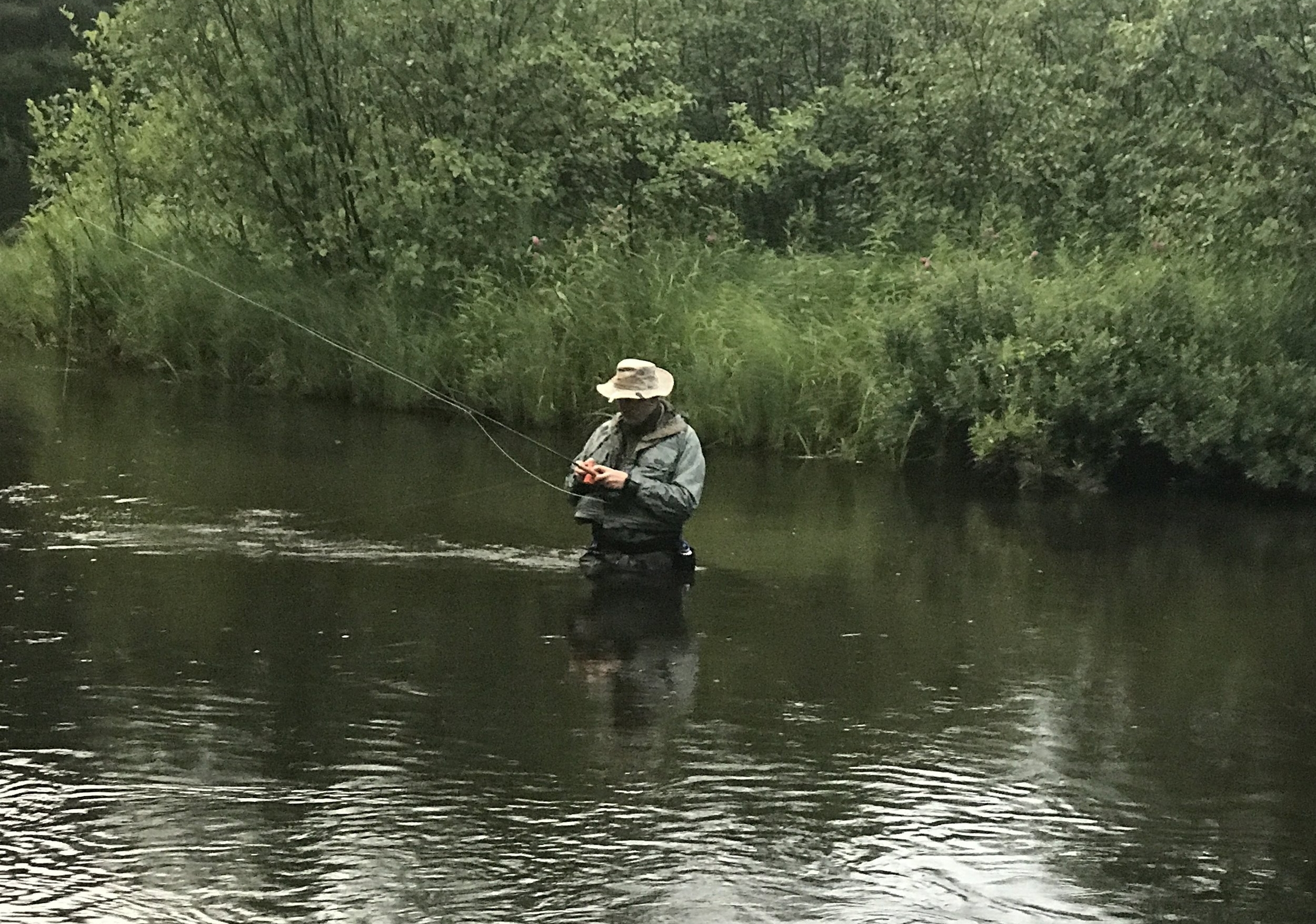 Fly fishing in river.JPG