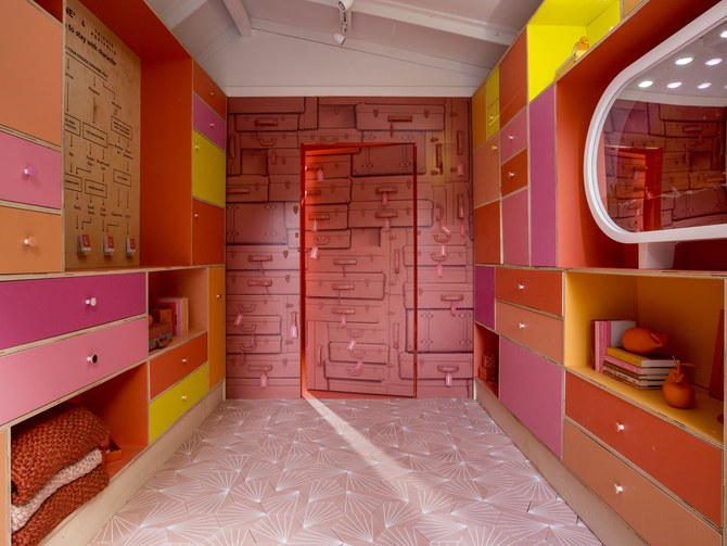 "Image courtesy of Architectural Digest.   The ""Pantone Pantry"" at Tribute Portfolio's Royal Palm hotel, host of Pantone's 2019 Colour of the Year reveal. The designated hue is ""Living Coral,"" shown on the back wall."