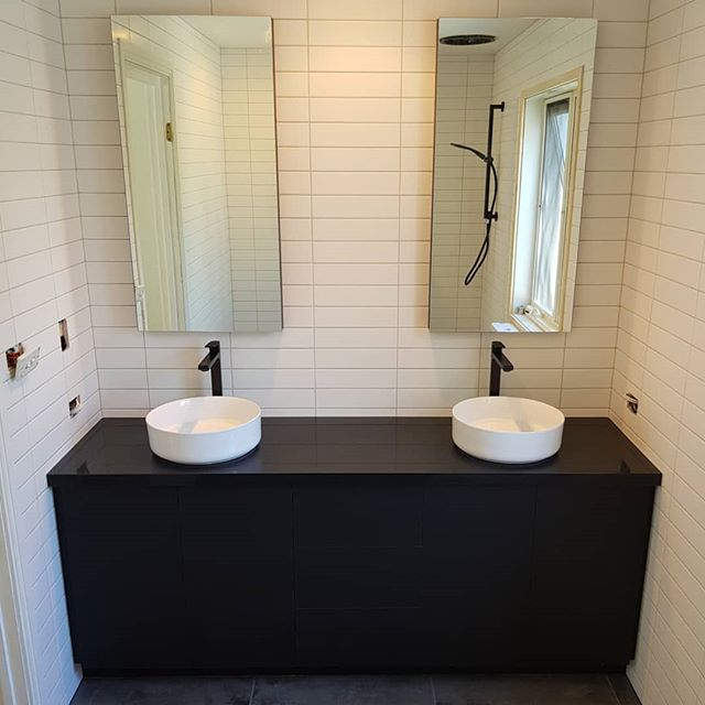 2 Matte black vanities with shaving cabinets just finished up this week.  The vertical surfaces are a Laminex product with the tops a Caesarstone 'jet black'. To achieve the handle less look, Blum movento tipons were used.