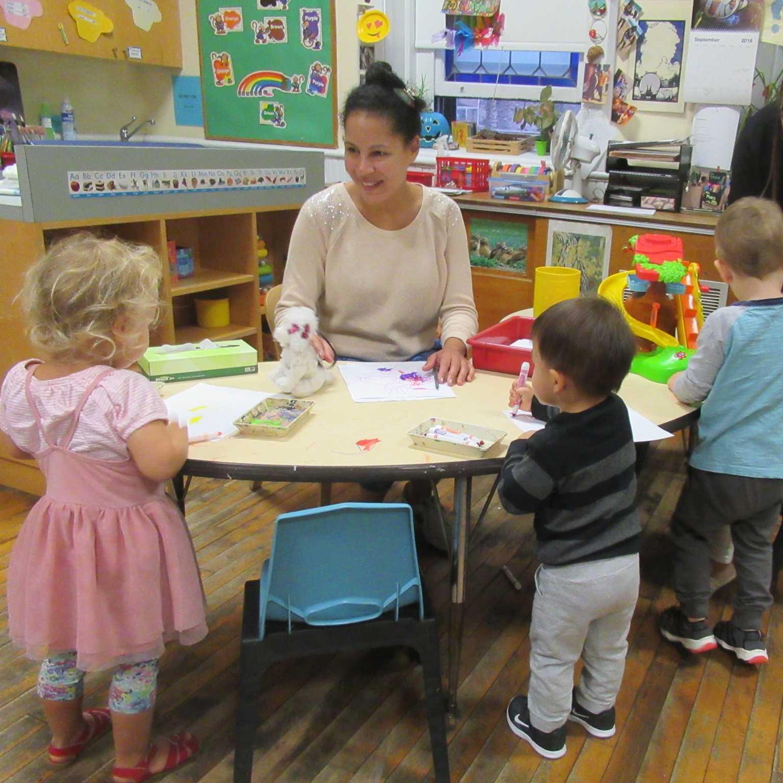 "Barbra Chigounis - Barbra has been the Lead Teacher in the Toddler Class since 2005. She captures children's interests through creative and developmentally appropriate lessons, capitalizing on everyday moments and establishing connective experiences. She supports self-expression, likes to improvise songs and games, tell interactive stories, and facilitate ""toddlerglyphics"" by exploring various fine art techniques."