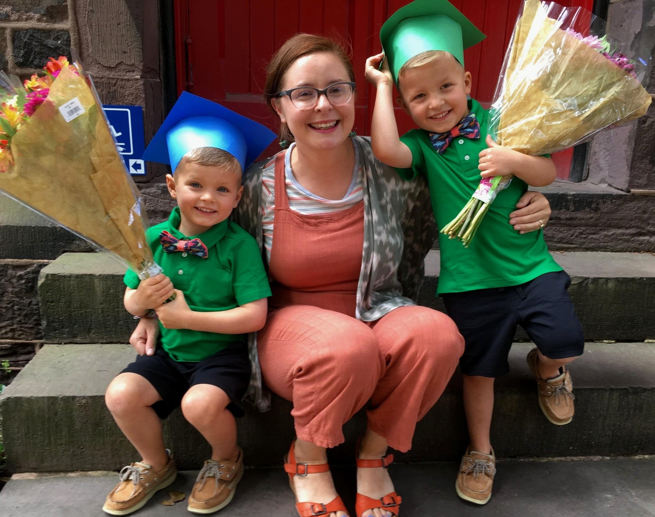 PreK teacher, Kelly Ann Davis with two proud graduates.