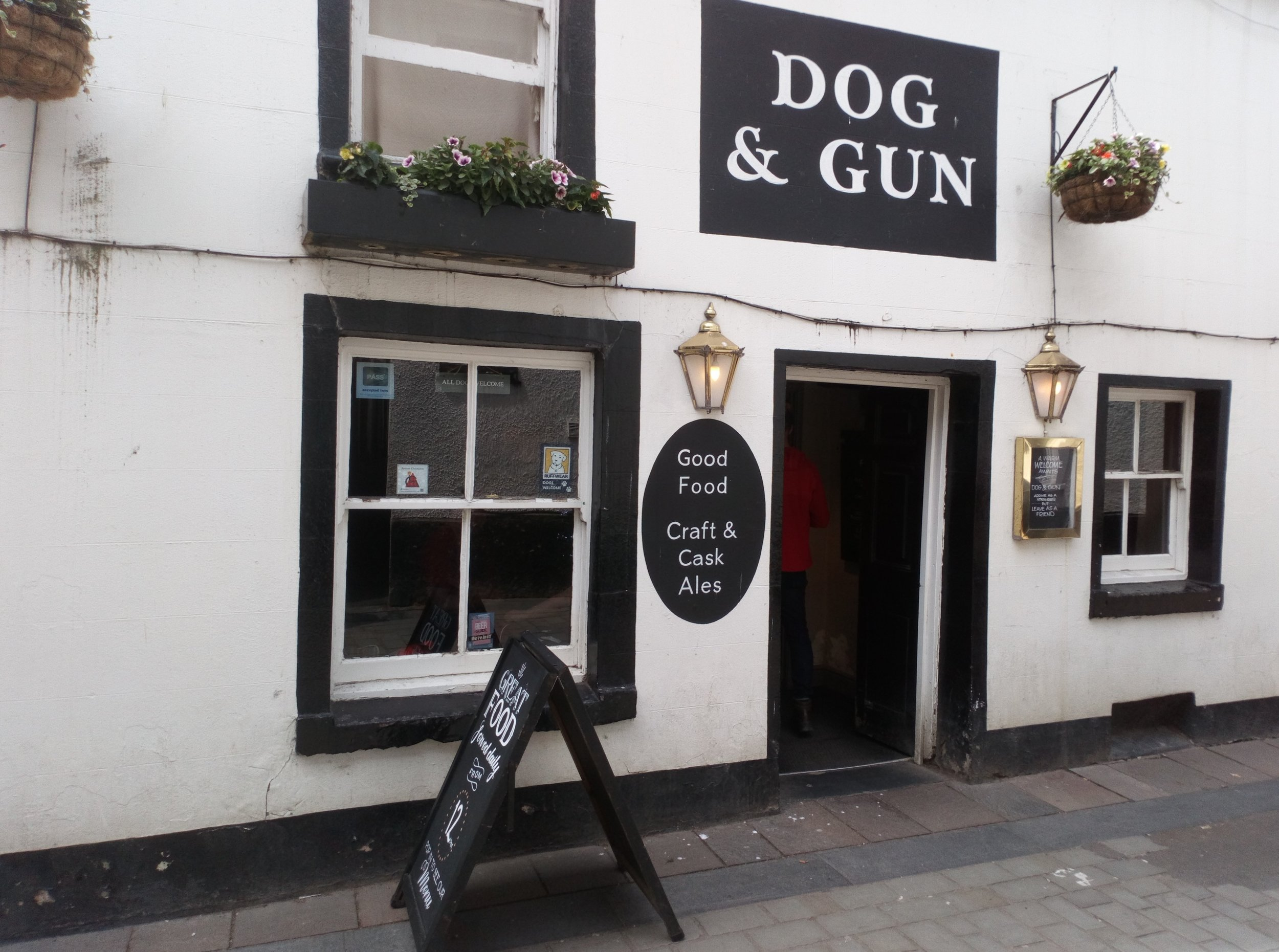 Dog & Gun    The Dog & Gun is one of Keswick's best-known pubs. It serves a selection of real ales and a menu to suit every taste. We are family friendly and provide a laid back and enjoyable environment to savour our real ales sourced within Cumbria and further afield. A weekly pub quiz gives you the chance to test your knowledge or just sit back and relax in our outdoor beer garden.  2 Lake Road,  Keswick, CA12 5BT  017687 73463