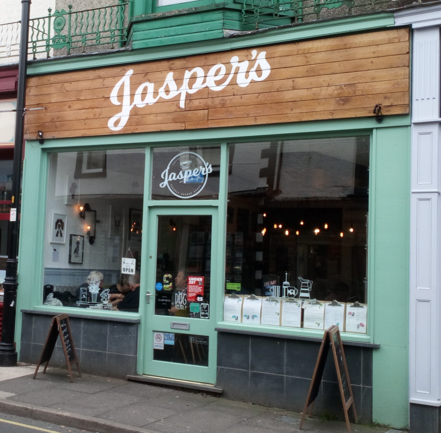 Jasper's   At Jasper's we believe we are the most dog friendly coffee shop in Keswick, specialising in Carvetti Coffee, loose leaf tea, smoothies, milkshakes and drip brewed iced coffee. We offer breakfasts, sandwiches, pittas, homemade cakes, fresh scones with jam and clotted cream. We also sell an extensive range of gluten free, vegetarian and vegan options. A takeaway menu is available; why not ring ahead and pre-order from us.  www.facebook.com/jaspersofkeswick  20 Station Street, Keswick, CA12 5HF  017687 73366
