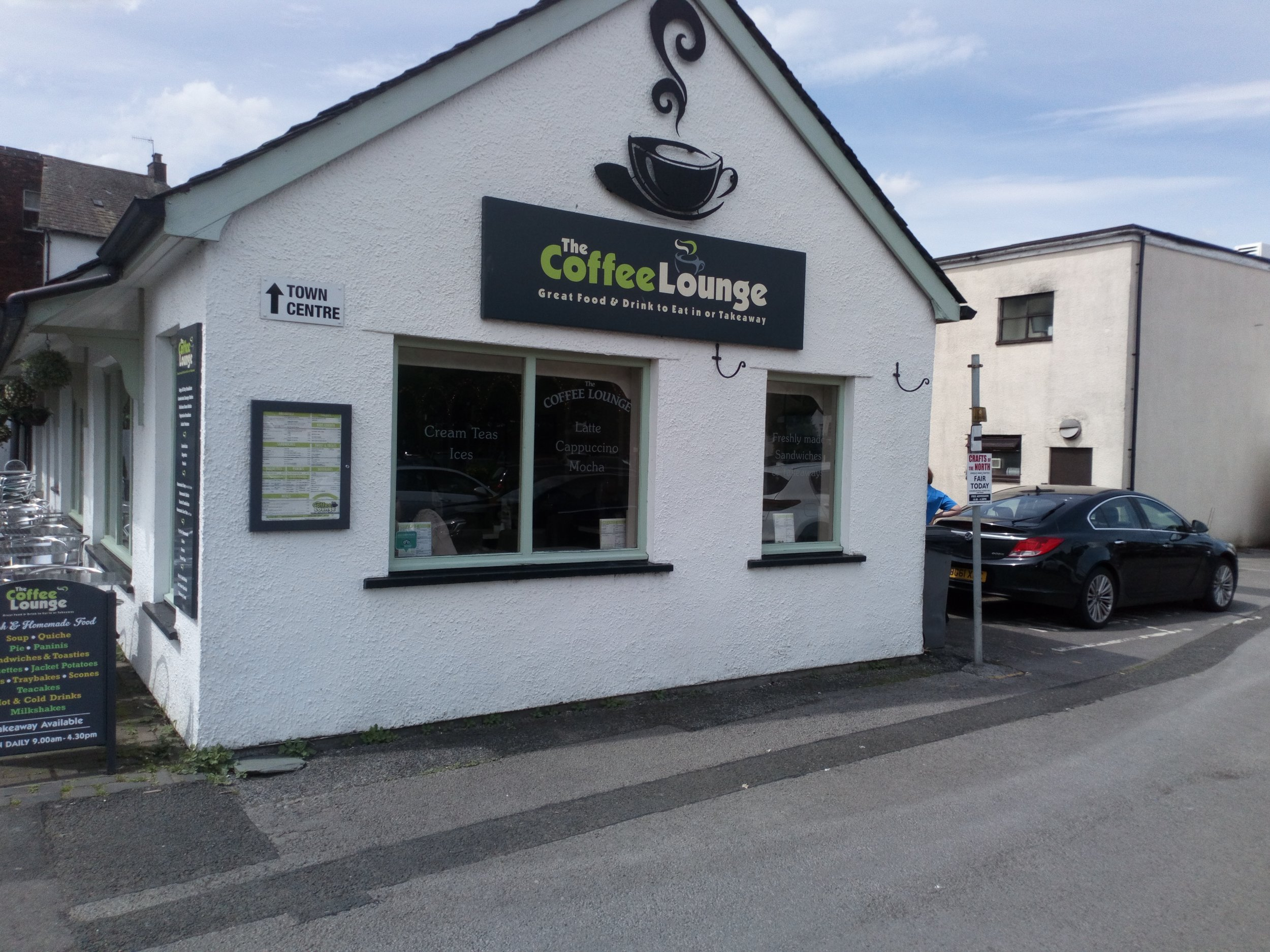 The Coffee Lounge   The Coffee Lounge is a family owned business in the centre of Keswick, providing freshly cooked meals, sandwiches, light snacks, and great tea and coffee and cold drinks in a relaxed, comfortable environment. We also offer a large selection of freshly baked cakes, tray bakes and scones, all made on the premises. We offer outside seating and a take-away service. Why not come along and relax and refuel before climbing your next mountain! Find us alongside Bell Close car park, away from the hustle and bustle of the main street. A warm welcome to all visitors is assured.  www.thecoffeeloungeinkeswick.co.uk  5 Luptons Court, Keswick, CA12 5JL  01768 773075