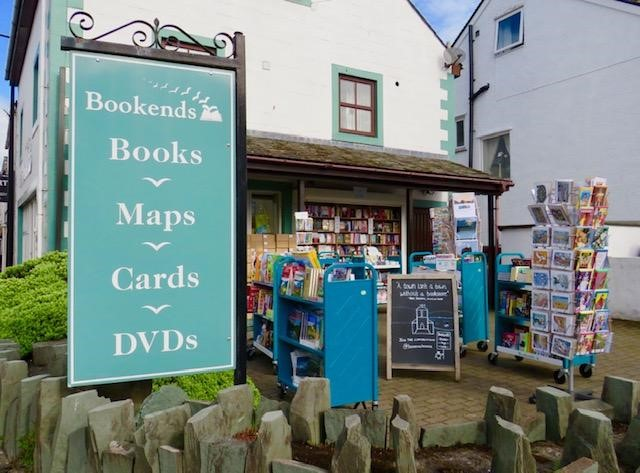 Bookends    Small but well-stocked, Bookends is an established independent bookshop offering hours of browsing and friendly customer service. Handily located on Main Street, we're open until 9.30pm during the summer, with a sun-trap courtyard for a relaxed shopping experience. On holiday? We offer free next-day delivery on a huge choice of books — no need to wait for the postman! We have a wide range of full-priced and reduced titles, including: • Christian and theology books • Local guides and maps • Children's books, including picture books, children's fiction and YA fiction • Gifts and stationery.  66 Main Street, Keswick, CA12 5DX  017687 75277