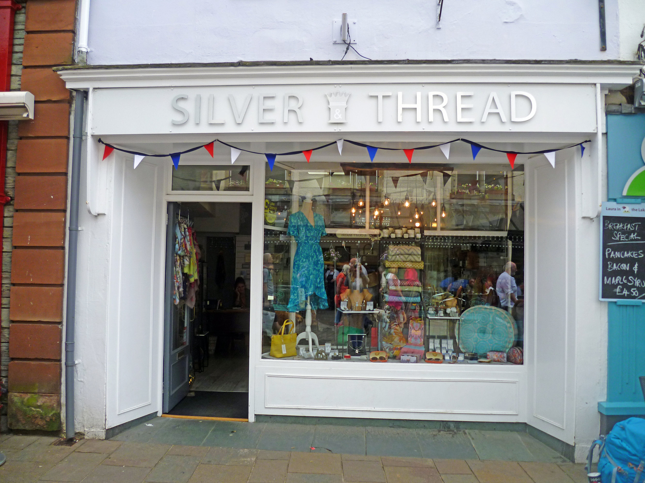 Silver Thread    We are based in central Keswick within the Market Square. We offer a stunning collection of timeless clothing all sourced from Denmark where quality is paramount, and is predominantly only found in independent boutiques like ours. We have beautiful silver jewellery to complete your look.Dew is high quality silver that's young, fresh and quirky. Our Israeli Silver is all handmade, each piece as unique as you are, much of which is inlaid with semi-precious stones.  Main Street, Keswick, CA12 5DS  017687 75558