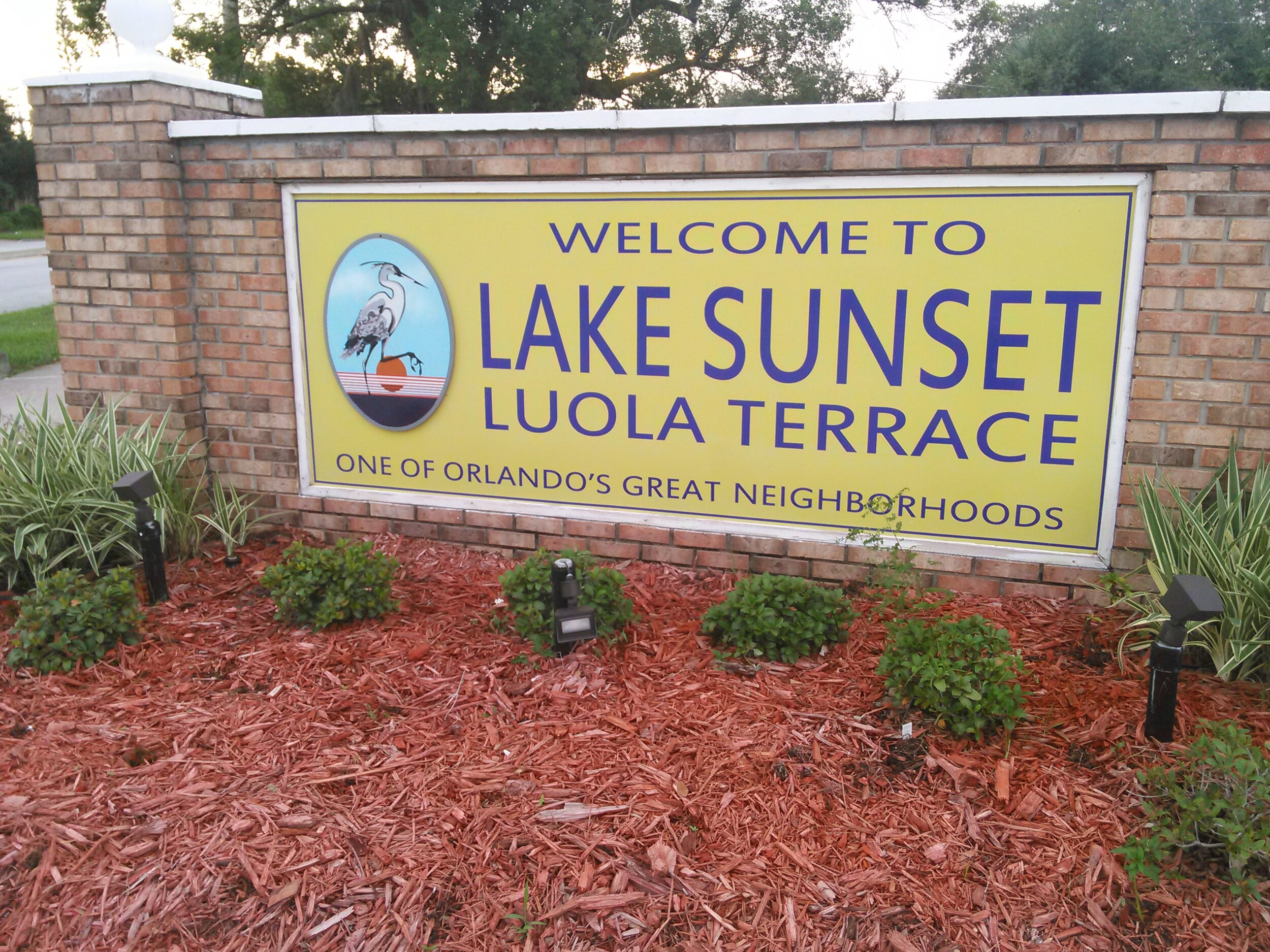 """LAKE SUNSET LUOLA TERRACE   Oldest of the West Lakes neighborhoods, established in 1925. Named for Orlando's  west lake on the edge of town facing the setting sun.  The """"Luola Terrace"""" area was established in 1957, named from Luola Cox, wife of early Orlando butcher & dairyman who owned the land. Home of Orange Center Elementary School and Lizzie Rodgers Park, named for community activist."""