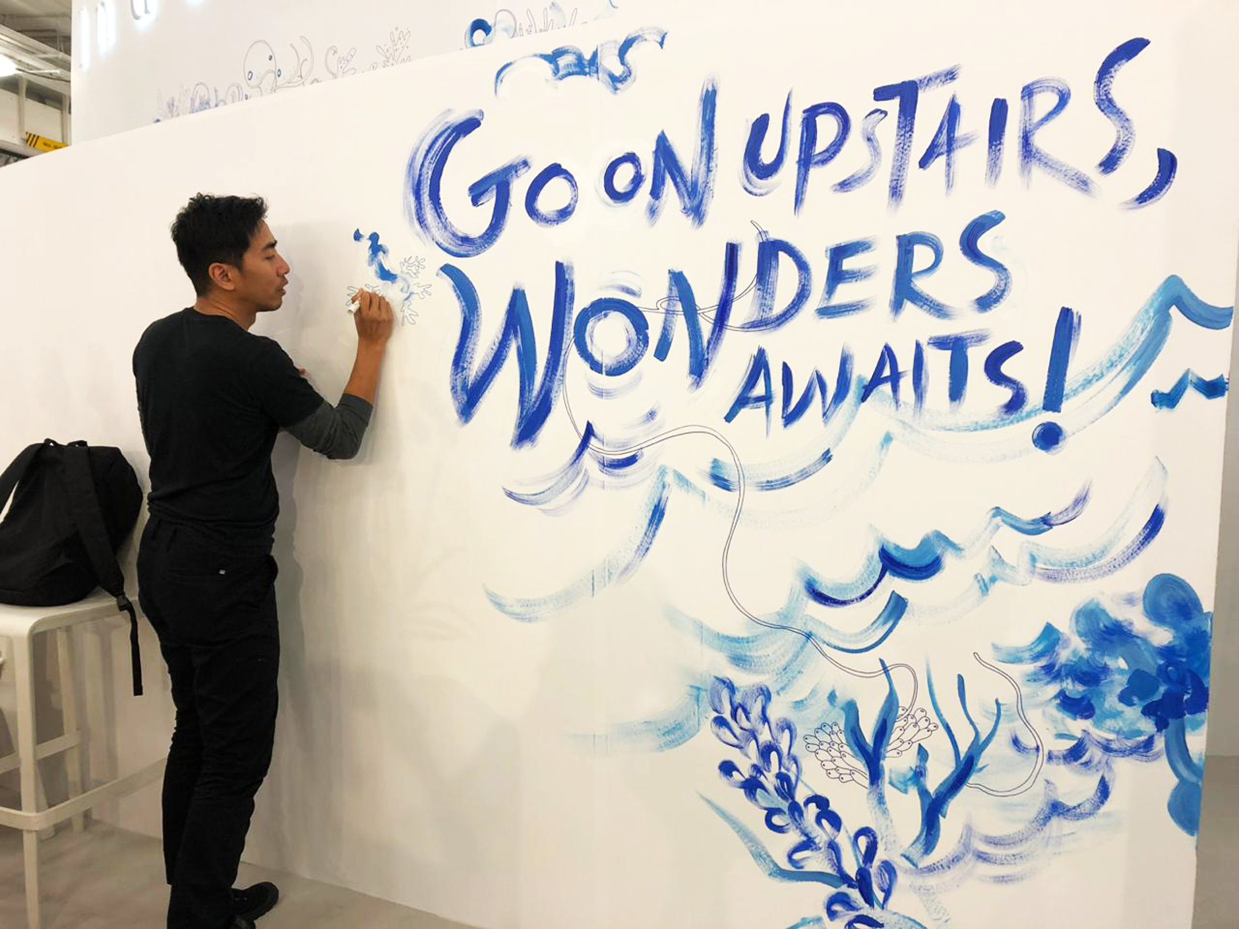 """Over the course of the London Book Fair, illustrator and artist Mohammad  """"Emte"""" Taufiq created an ocean-themed mural for the Indonesian national  pavilion. (Photo courtesy of Siti Gretiani)"""