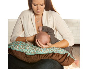 Uncomfortable mom trying breastfeeding positioning