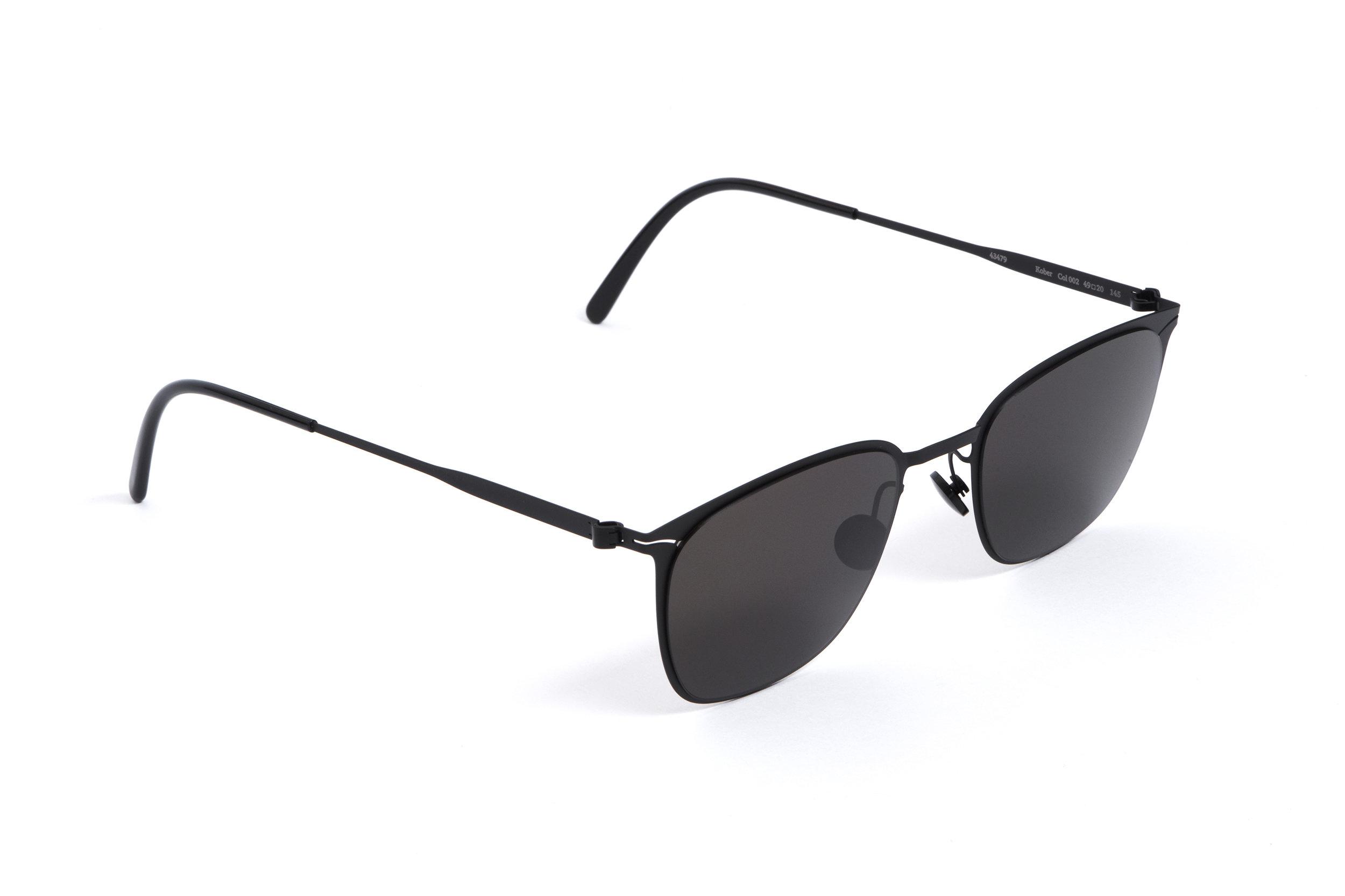 haffmans_neumeister_kober_black_black_grey_line_sunglasses_angle_102424.jpg