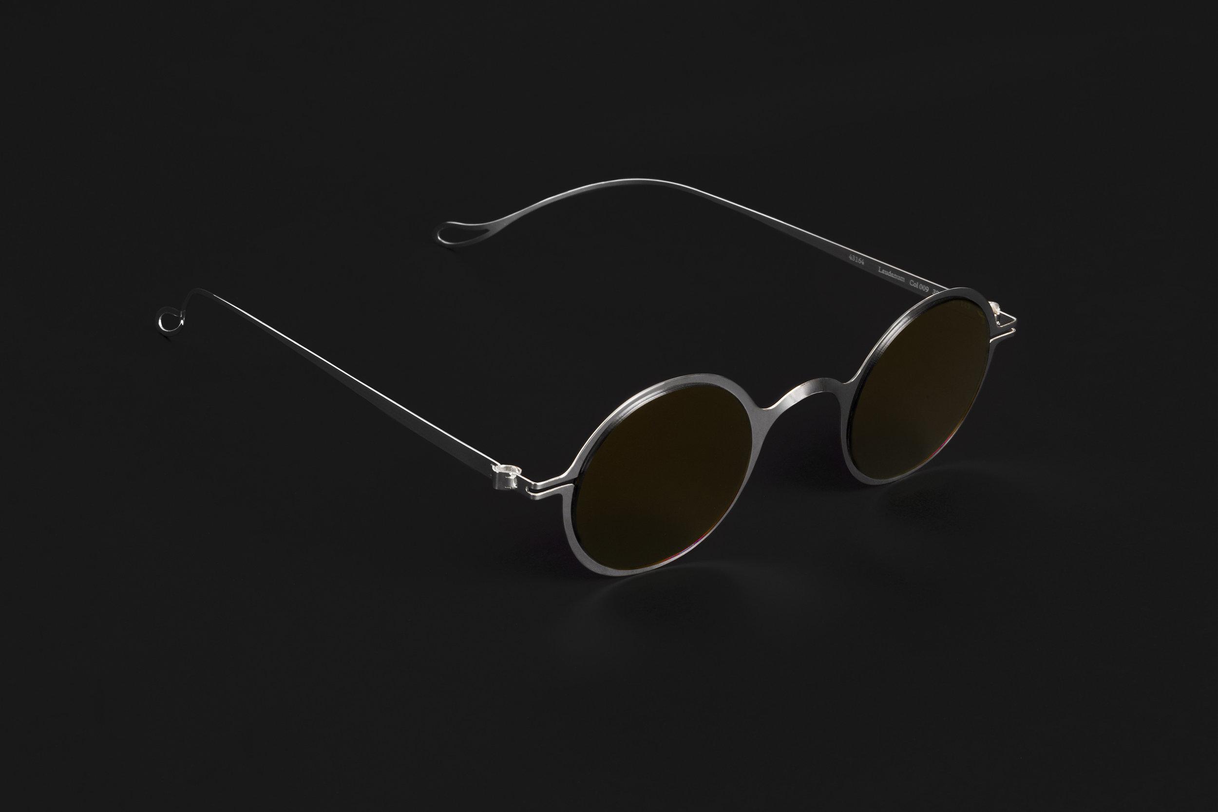haffmans_neumeister_laudanum_argentum_amber_brown_phasmid_sunglasses_angle_102225.jpg