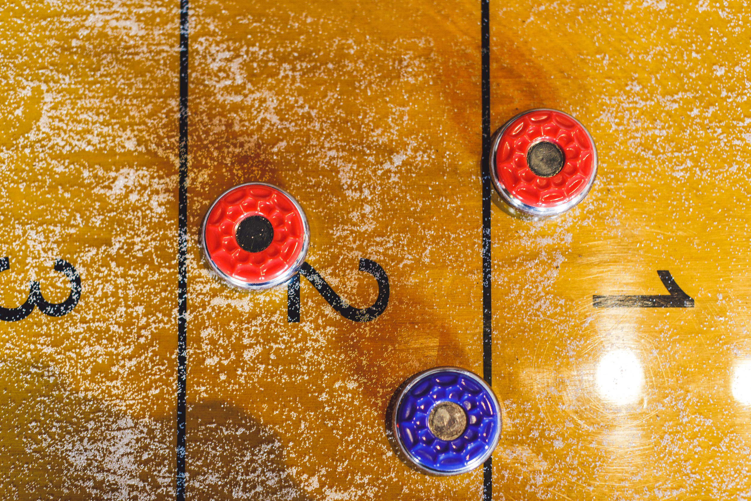 TABLETOP SHUFFLEBOARD - It's like Olympic curling…but without the frozen toes and all that frantic sweeping. With a little finesse, anyone can play and win at this barroom favorite.