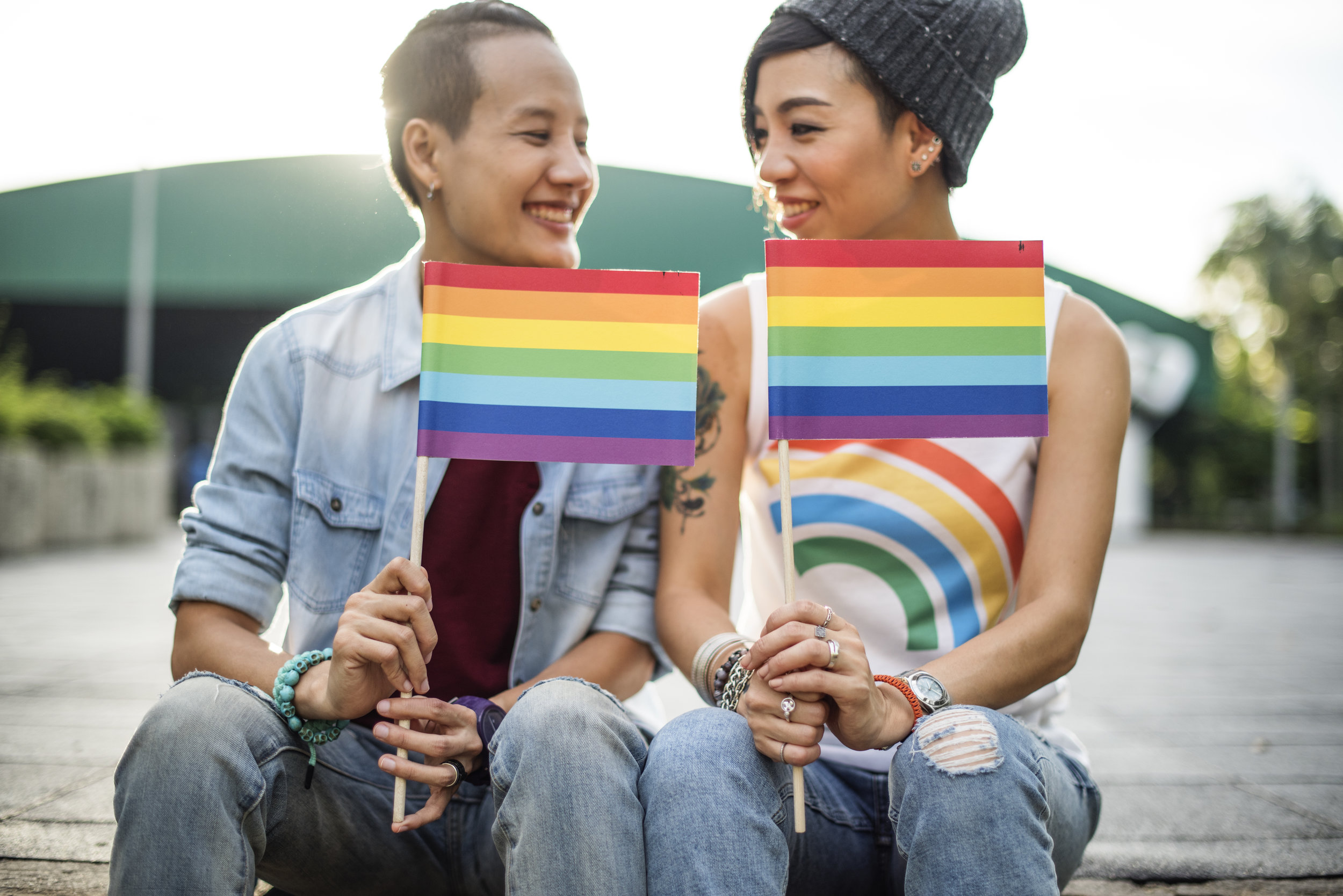 Same-sex couple with pride flags