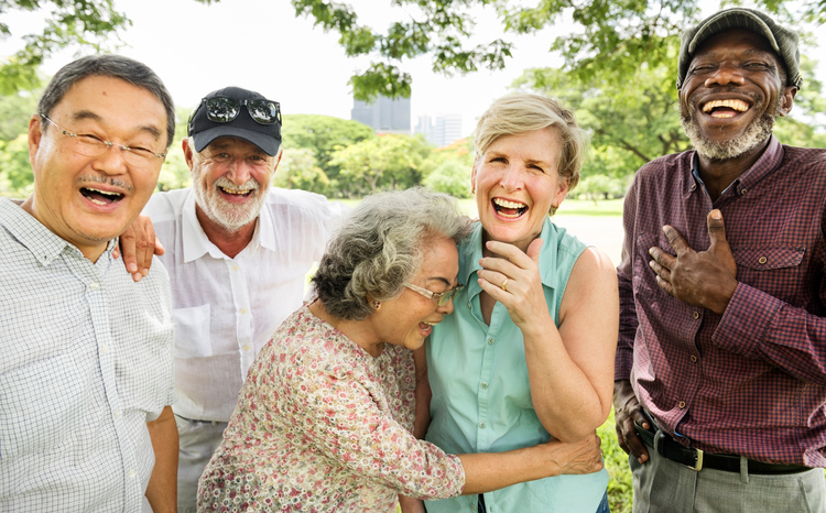 Group of seniors laughing outdoors