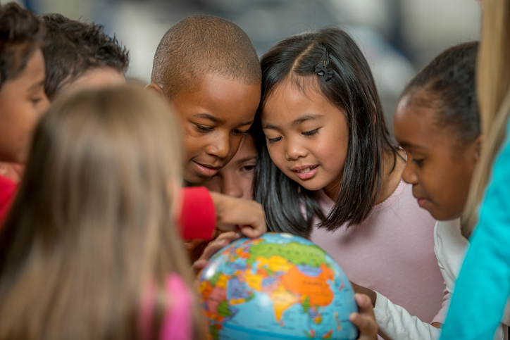 Group of children looking at a globe