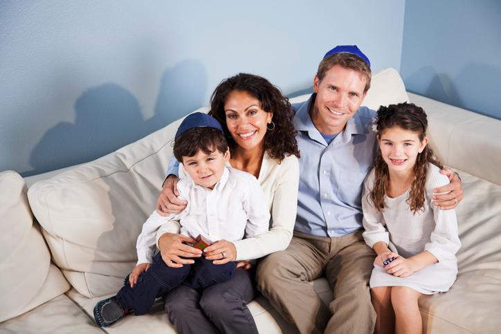 Family posing on a sofa