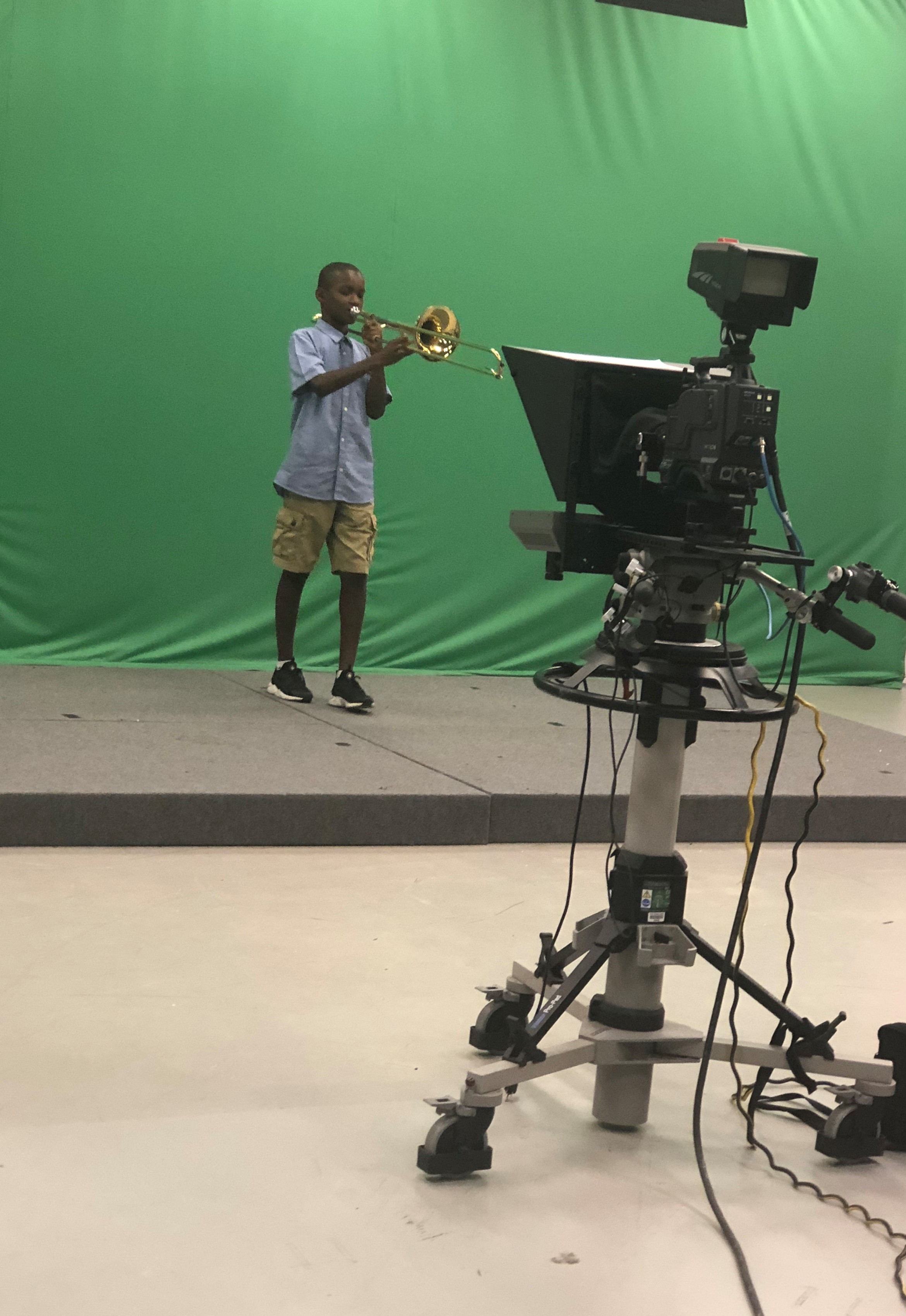 Displaying my musical talents during a special segment on a children's program