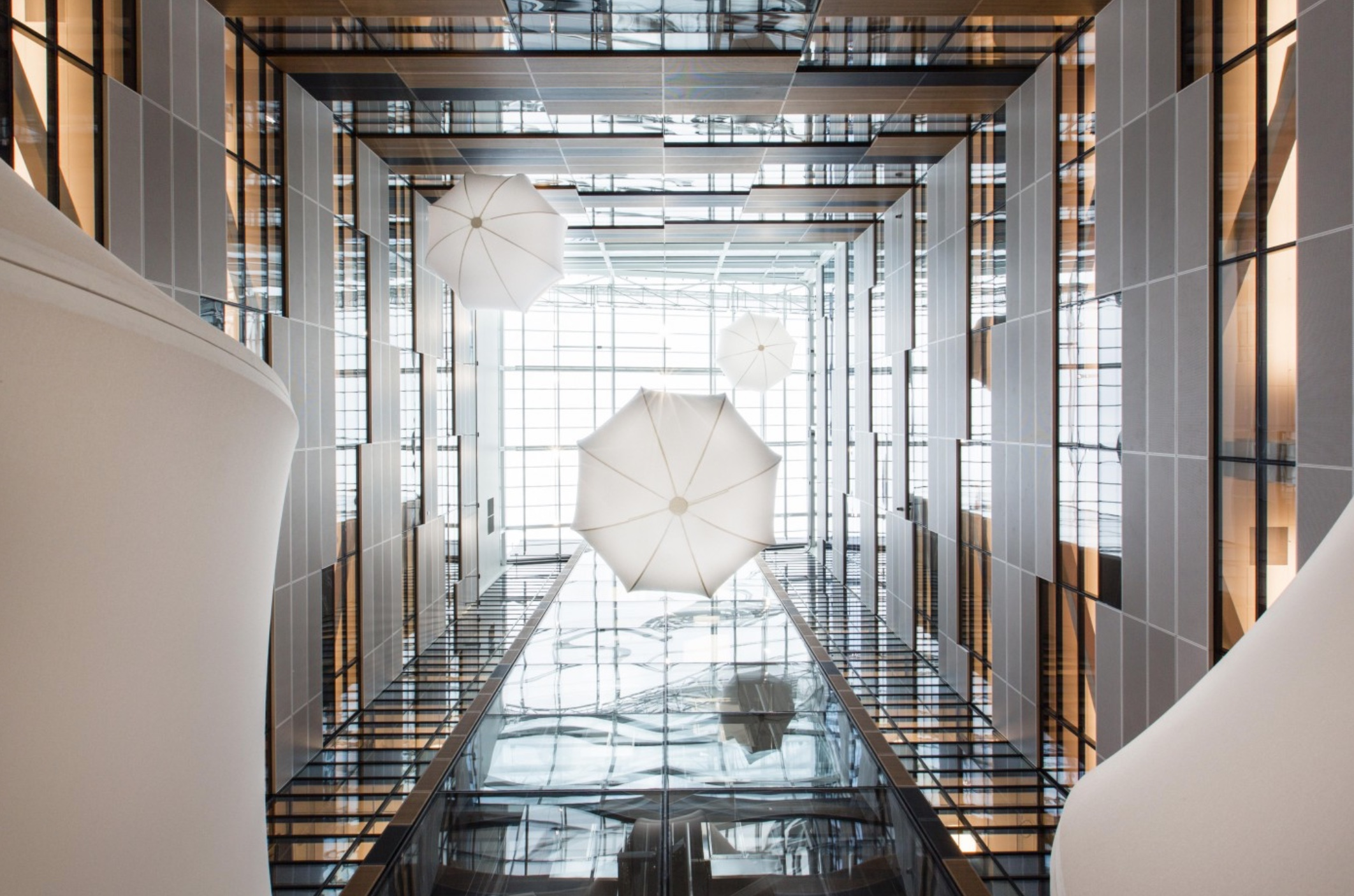 …and looking up, three giant bubbles slowly rise and sink through space, which can be seen from all floors.    Bubbles by Tobias Allanson, Photo by Per Ranung