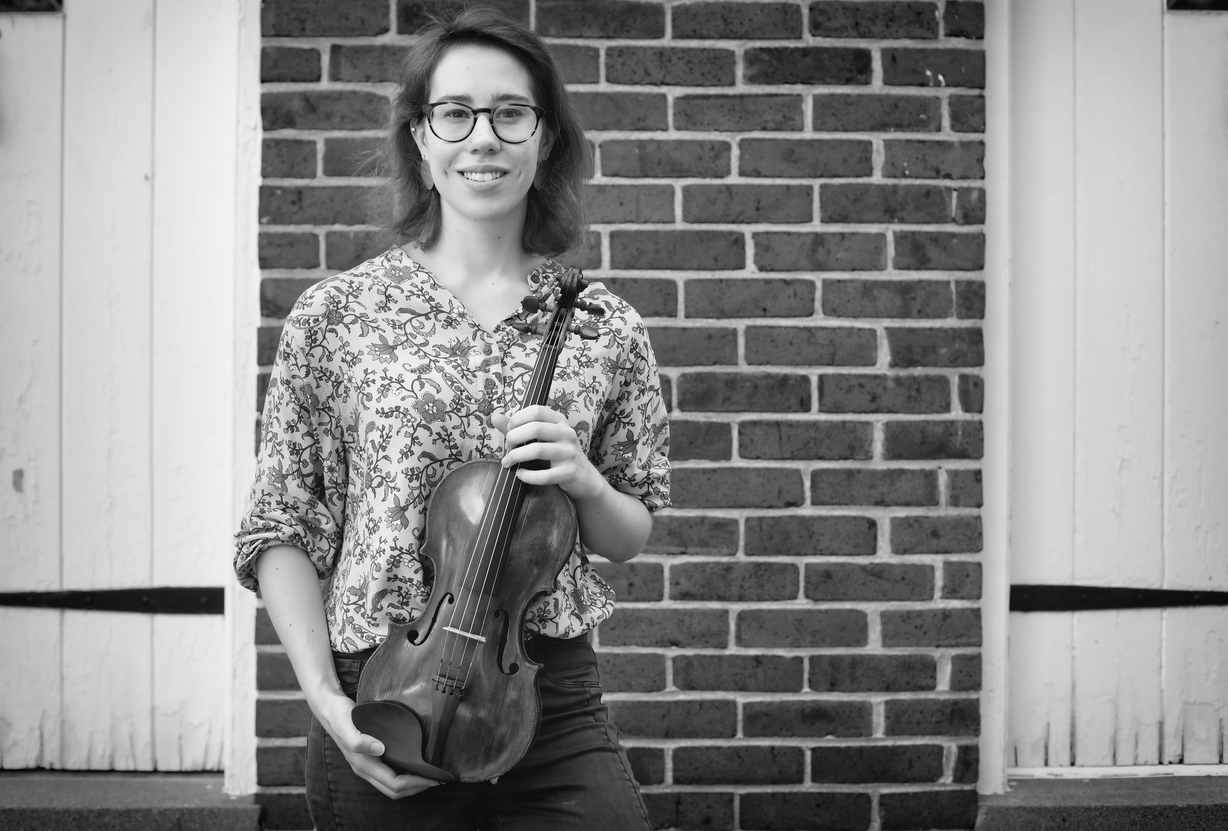 Sarah COle: Violin - Sarah Cole holds Masters Degrees in both violin performance and string pedagogy. She has studied at the University of Louisville, the Royal Welsh College of Music and Drama in Wales, and at Baldwin Wallace Conservatory in Ohio. She currently plays with Orchestra Kentucky and Paducah Symphony, as well as freelancing in the Louisville area. While at U of L, she served as Concertmaster in the university's orchestra. She also performed in the university's Graduate String Quartet and worked as a Teaching Assistant there. In London, Sarah's chamber ensemble was a finalist for the Cavatina Chamber Music Competition at the Royal Academy of Music. Also in Britain, while as a member of the Royal Welsh String Soloists Ensemble, she was invited to Buckingham Palace to perform at a gala for Prince Charles.In Louisville, Sarah gives recitals and regularly performs with other local musicians. Sarah has performed in master classes for notable musicians such as Simon Fisher, ItzhakRashkovsky, and Daniel Phillips, and recently studied with David Updegraff, Patrick Rafferty, and Rachel Podger. In her spare time, Sarah enjoys hiking, traveling, and drinking coffee.